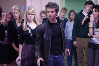 Alice (Alice Eve) and other students watch as Spencer (Dominic Cooper) preps for a fight in