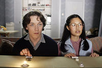 Brian (James McAvoy) and Lucy (Elaine Tan) train for a quiz show in