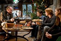 Director David Yates, Rupert Grint, Daniel Radcliffe and Bonnie Wright on the set of
