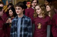 Daniel Radcliffe as Harry Potter, Matthew Lewis as Neville Longbottom, Emma Watson as Hermione Granger and Bonnie Wright as Ginny Weasley in