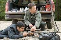 Nick Memphis (Michael Pena) sets his sights as Bob Lee Swagger (Mark Wahlberg) helps him find the target in