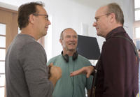 Kevin Costner, director Bruce A. Evans and William Hurt on the set of