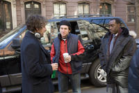 Adam Sandler, director Mike Binder and Don Cheadle on the set of