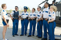 In Miami, Lt. Dangle (Thomas Lennon) reviews some strategy with his team in