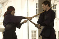 Lady Murasaki (Gong Li) and  Hannibal (Gaspard Ulliel) in