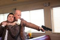 Joseph Gordon-Levitt and Bruce Willis in Looper