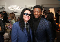 Tommy Wiseau and Chadwick Boseman