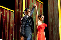 Caesar Flickerman (Stanley Tucci) and Katniss Everdeen (Jennifer Lawrence).