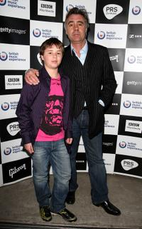 Glen Matlock and Guest at the opening of the British Music Experience.