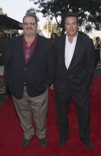 John Milius and William MacDonald at the premiere of