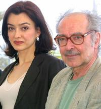 Cecile Camp and Director Jean-Luc Godard at the photocall of