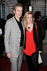 Peter Capaldi and guest at the gala premiere of
