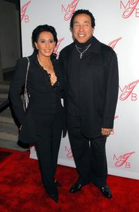 Frances Gladney and Smokey Robinson at the Will and Jada Smith party.