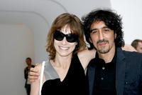 Stefania Rocca and director Sergio Rubini at the Costume National Homme fashion show.