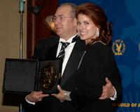 Barry Sonnenfeld and Debra Messing at the press room at the 60th annual DGA Awards held at the Hyatt Regency Century Plaza Hotel.