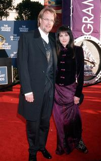 John Tesh and Connie Sellecca at the 41st Annual Grammy Awards.