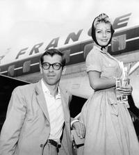 Picture circa 1960 of French director Roger vadim and Denmarks actress Annette Stroyberg boarding on a flight.