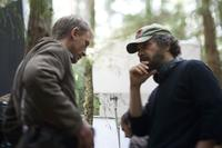 Director Edward Zwick and Daniel Craig on the set of