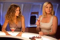 Sarah Jessica Parker as Carrie Bradshaw and Kim Cattrall as Samantha Jones in