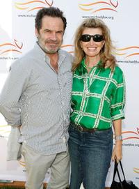 Dennis Miller and Ali Espley at the Michael J. Fox Foundation for Parkinson's Research Summer Lawn Party.