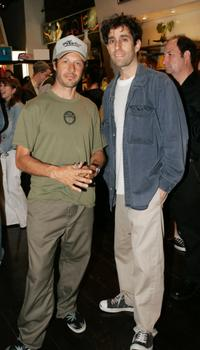 Tony Alva and Glen Friedman at the opening of