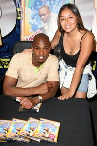 Dave Chappelle and Mira Farfan at the signing of DVD copies of