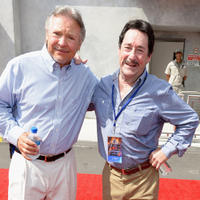 Frank Welker and Peter Cullen at the Transformers The Ride - 3D Grand Opening Celebration.