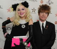 Rodney Bingenheimer and Guest at the 50th anniversary birthday bash of the Hollywood Walk of Fame.