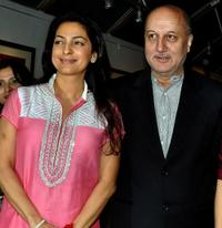 Juhi Chawla and Anupam Kher at the inauguration of artist Geeta Dass's exhibition of paintings.