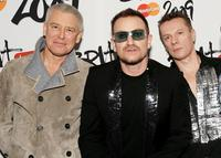 Adam Clayton, Bono and Larry Mullen Jr. at the Brit Awards 2009.