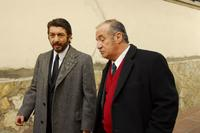 Ricardo Darin as Benjamin Esposito and Jose Luis Gioia as Inspector Baez in