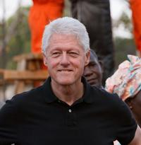 Bill Clinton at the rural hospital construction site in the village of Neno.
