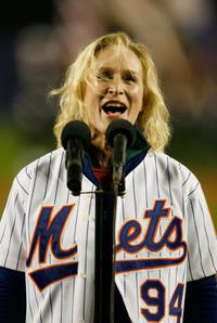 Glenn Close at the Shea Stadium sings the National Anthem before the New York Mets play the St. Louis Cardinals in game seven of the NLCS.