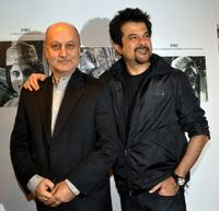 Anupam Kher and Anil Kapoor at the inauguration of artist Geeta Dass's exhibition of paintings.
