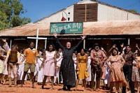 Geoffrey Rush as Father Benedictus and the cast of