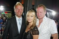 Director Renny Harlin, Izabella Scorupco and Stellan Skarsgard at the premiere of