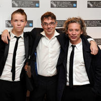 Will Poulter, Charlie Creed-Miles and director Dexter Fletcher at the London premiere of