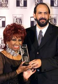Celia Cruz and Luis Guerra at the Latin Billboard Music Awards.