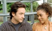 John Cusack and Sophie Okonedo in