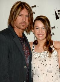 Billy Ray Cyrus and Miley Cyrus at the 2006 American Music Awards.