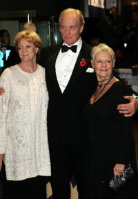 Dame Maggie Smith, Charles Dance and Dame Judi Dench at the CTBF Royal Film Performance 2004 -