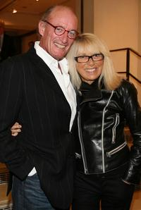 Mireille Darc and her husband at the Alain Delon pre-launch cocktail party.