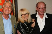 Mireille Darc, her husband and Pierre Cornette at the Alain Delon pre-launch cocktail party.