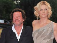 Joaquim de Almeida and Charlize Theron at the premiere of