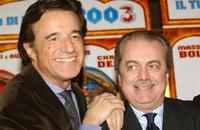 Christian De Sica and Aurelio De Laurentis at the premiere of