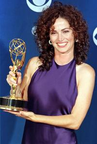 Kim Delaney of 'NYPD Blue' poses with her Emmy.