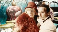 Maggie Steed as LV Woman and Johnny Depp as Imaginarium Tony 1 in
