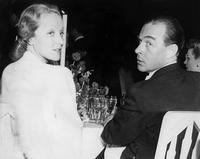 Marlene Dietrich and her friend German writer Erich Maria Remarque at dinner.