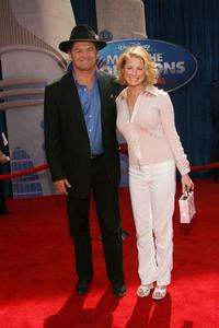 Micky Dolenz and Guest at the premiere of