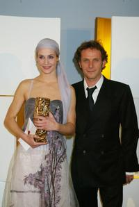 Charles Berling and Cecile De France stand after the Cesars film awards.